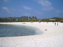 Image of pristine white coral sands and turquoise water