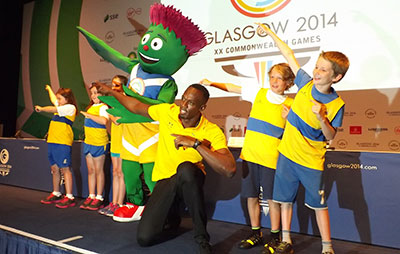Usain Bolt with kids in Glasgow