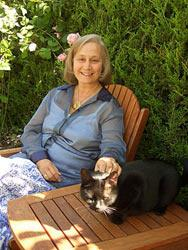Aline with her cat Raju in her garden